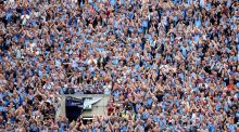 Dublin fans create an atmosphere on Hill 16. Tickets for the county's All-Ireland semi-final clash with Mayo sold out very quickly. Photograph: James Crombie/Inpho