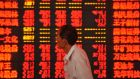 Ups and downs: stock-market prices at a Chinese securities firm. Photograph: AFP/Getty