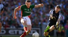 Mayo's Andy Moran fires past Stephen Cluxton in the  2013 All-Ireland football final at Croke Park. Photographer: Dara Mac Dónaill