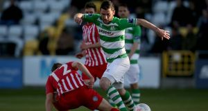 Sligo Rovers' Sander Puri tackles Ryan Brennan of Shamrock Rovers during the sides' Airtricity League clash at the Showgrounds last night. Photo: Donall Farmer/INPHO