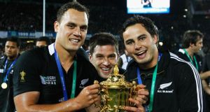 Israel Dagg, Cory Jane and Zac Guildford of the All Blacks pose with the Webb Ellis Cup after victory in the 2011  Rugby World Cup final over France.  Photo: Phil Walter/Getty Images)