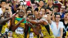 Nickel Ashmeade, Usain Bolt, Nesta Carter and Astafa Powell take a picture with fans after winning gold in the 4x100m men relay during the Beijing 2015 IAAF World Championships at the National Stadium. Photo: Diego Azubel/PA