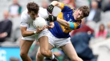 Kildare's Conor Hartley and Tipperary's Emmett Moloney, who was sent off during the  All-Ireland minor football semi-final at  Croke Park. Photograph: Inpho