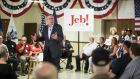 """A lethargic, insubstantial image of Jeb Bush that is at odds with the perky red 'Jeb!' campaign logo"". Photograph: Reuters/Jay Westcott"