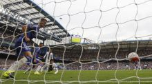 Crystal Palaces defender Joel Ward heads home the winning goal against Chelsea at Stamford Bridge. Photograph: Ian Kington/AFP