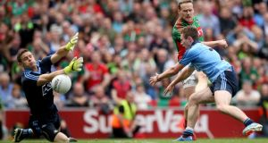 Dublin's goalkeeper Stephen Cluxton and Jack McCaffrey block  a goalbound effort from Mayo's Andy Moran in  yesterday's All-Ireland Football Championship semi-final in Croke Park. Photograph:  James Crombie/Inpho