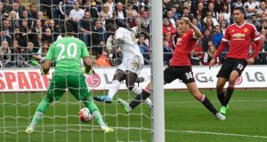 Bafétimbi Gomis scores the second goal for Swansea against Manchester United during the  Premier League match at Liberty Stadium. Photograph: Reuters