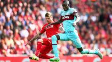 Cheikhou Kouyate and Alberto Moreno of Liverpool compete for the ball at Anfield. Photograph: Clive Mason/Getty Images