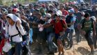Migrants rush into Serbia over the border with Macedonia last week. Fianna Fáil spokesman on Europe Timmy Dooley criticised Minister's refusal to step up  response to the crisis.  Photograph: Darko Vojinovic/AP Photo