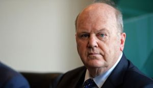 Minister for Finance Michael Noonan  removed a citizenship clause so individuals couldn't avoid the tax by renouncing their citizenship. Photograph: Eric Luke