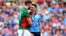 Philly McMahon of Dublin with Aidan O'Shea of Mayo. Photograph: Donall Farmer/Inpho