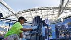 Final preparations at the Arthur Ashe Stadium for the US Open tennis tournament which begins on Monday in New York. Photograph: Julie Jacobson/AP