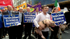 Farmers march with cows and pigs in Dublin protest