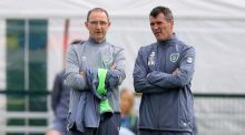 Republic of Ireland manager Martin O'Neill and his assistant Roy Keane watch Ireland training. Photograph: Donall Farmer/Inpho