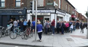 Dublin GAA fans queue down Belvedere Road  as they wait to  to purchase tickets at the GAA ticket office on Dorset Street for this Saturday's eagerly-awaited All-Ireland football semi-final replay. Photograph: Maxpix.