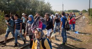 Migrants near Szeged, Hungary, after crossing the border from Serbia. Photograph: Matt Cardy/Getty Images