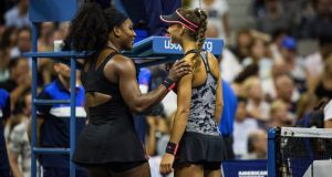 Serena Williams of the U.S. and Vitalia Diatchenko of Russia talk after Diatchenko retired from their match during the U.S. Open tennis tournament at Arthur Ashe Stadium in New York. Diatchenko appeared severely hobbled from the start, unable to move well, and retired in the second set. Photo: Todd Heisler/The New York Times