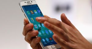 The new Samsung Galaxy S6 Edge: You can pick it up relatively cheaply on contract but, sim free, it will set you back around €900 for the 64GB version.  Photograph: Gustau Nacarino/Reuters