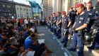 Migrants stage a sit-down demonstration as police block the entrance to Keleti train station in Budapest on Tuesday. Photograph: Laszlo Balogh/Reuters