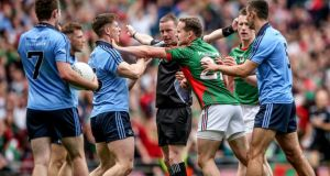 Referee Joe McQuillan awards Mayo a penalty on Sunday. With no help from a TMO, a ref must depend on linesmen who pick up only half of what's going on and umpires who are just along for the ride. Photograph: James Crombie/Inpho