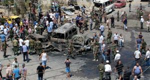Syrians gather at the site of a car bombing after a rare attack on the port city of Latakia. Photograph: AP