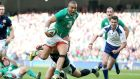 Ireland's Simon Zebo rides the tackle to break free and score a try. Photograph: Dan Sheridan/Inpho