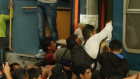 Migrants surge into Budapest railway station