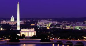 The Washington, DC skyline at night, including the Washington Monument, Capitol building and Lincoln Memorial