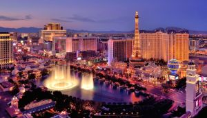 The fountains of the Bellagio light up in the middle of the Las Vegas strip