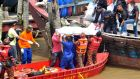 Rescuers carry a body recovered from a capsized boat at a jetty in Hutan Melintang, near Teluk Intan, Malaysia. Photograph: Reuters