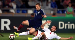 Scotland's Shaun Maloney is tackled by   Georgia's Guram Kashia during the Euro 2016  Group D qualifier in Tbilisi. Photograph:    Nick Potts/PA