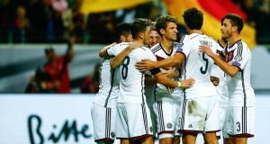Germany moved to the top of Euro 2016 qualification Group D after a 3-1 win over Poland in Frankfurt. Photograph: Reuters