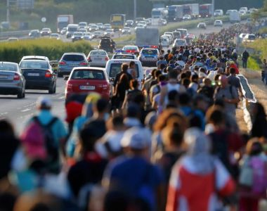 Refugees walk along the highway towards the border with Austria, out of Budapest, on Friday. Photograph: Laszlo Balogh/Reuters