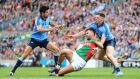 Mayo's Aidan O'Shea under pressure from Cian O'Sullivan and Philly McMahon of Dublin during the All-Ireland semi-final. Photograph:  Cathal Noonan/Inpho