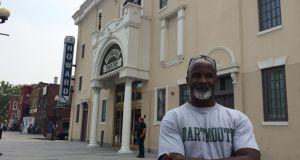 Martin Moulton, community activist and resident of the Shaw neighbourhood in Washington DC, outside the historic Howard Theatre.