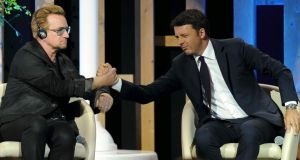 Bono and Italian prime minister Matteo Renzi at Expo 2015 in Milan last night. Renzi acknowledged that Italy could provide more food aid and distribution. Photograph: Reuters/Alessandro Garofalo