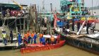 A body from an Indonesian capsized boat victim carried by Malaysian rescuers. Photograph: Malaysian Enforcement Angency/EPA/handout