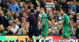 Referee Istvan Vad issues a yellow card to Republic of Ireland's James McClean for a challenge on Georgia's Giorgi Papunashvili  at the Aviva Stadium. Photograph: Cathal Noonan/Inpho