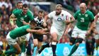 Joe Marler of England hands off Conor Murray of Ireland during the World Cup warm-up game  at Twickenham. Photograph: Clive Rose/Getty Images