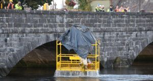 The scene at Thomond Bridge in Limerick on Saturday evening as the cage structure was lifted out of the water. Photograph: Liam Burke/Press 22