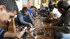 Migrants charging their mobile phones at Keleti railway station in Budapest last week. Photograph: Herbert P Oczeret/EPA