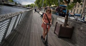 Leonie Corcoran tests out an electric scooter for her commute. Photograph: Sara Freund