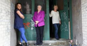 Ciara Dunlop, Rene Crawford and Greta Doherty outside a block of derelict flats on the Lenadoon estate in west Belfast. Photograph: Stephen Davison/Pacemaker