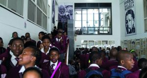 Schoolchildren in Cape Town visit Robben Island; the island's visitor centre is funded by Atlantic Philanthropies. Photograph by magnum from the book laying the foundations for change