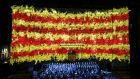 The Catalan flag on the facade of the Palau de la Generalitat in Barcelona during a ceremony to mark national day. Photograph: Gustau Nacarino/Reuters
