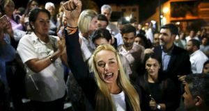 Lilian Tintori (C), wife of jailed opposition leader Leopoldo Lopez, shouts during a news conference in Caracas. Photograph: Carlos Garcia Rawlins/Reuters.