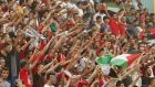 Supporters of Palestine's  football team cheer and fly their national flag during their 2018 World Cup qualifying soccer match against the United Arab Emirates,  in the occupied West Bank this week. Photograph: Ammar Awad/Reuters