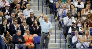 Former tennis star James Blake waves to the crowd as receives an ovation at the US Open. Photograph: Andrew Gombert/EPA
