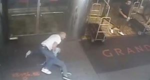 A frame grab from a surveillance video released by the New York Police Department  shows an undercover New York City police officer arresting former professional tennis payer James Blake in New York. Blake, who was in front of a hotel waiting to attend the US Open, was misidentified by police as a suspect in a credit card fraud scheme. Photograph: EPA/NYPD