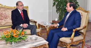 Outgoing oil minister Sharif Ismail meeting with Egyptian president Abdel Fattah al-Sisi  at the presidential palace in Cairo. Photograph: AFP/Getty Images